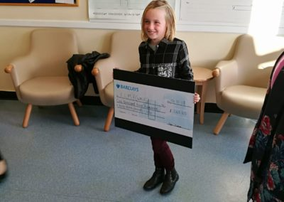 Sofie Joshua - a little girl with a big cheque!